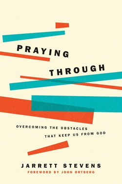 Front cover image of Praying Through, by Jarrett Stevens.